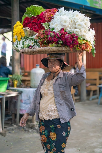 A woman selling flowers in Mandalay, Myanmar - Daniel John Photography