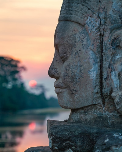 A face in front of a sunset in Siem Reap Cambodia - Daniel John Photography