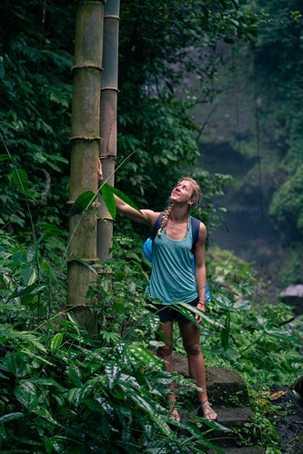 A woman touching huge bamboo shoots in Bali, Indonesia - Daniel John Photography