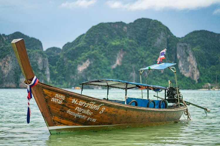A Thai long-tail boat anchored on Phi Phi Island Thailand - Daniel John Photography