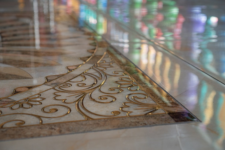 A decorated floor tile with colorful reflections at Batu Caves, Malaysia - Daniel John Photography