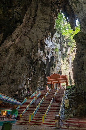 A stairwell and colorful shrine in Batu Caves, Malaysia - Daniel John Photography