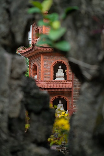 Tran Quoc Pagoda through a stone in Hanoi Vietnam - Daniel John Photography