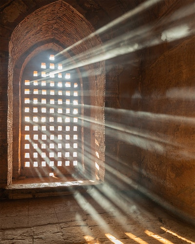 Light rays coming through a smokey window in Bagan, Myanmar - Daniel John Photography