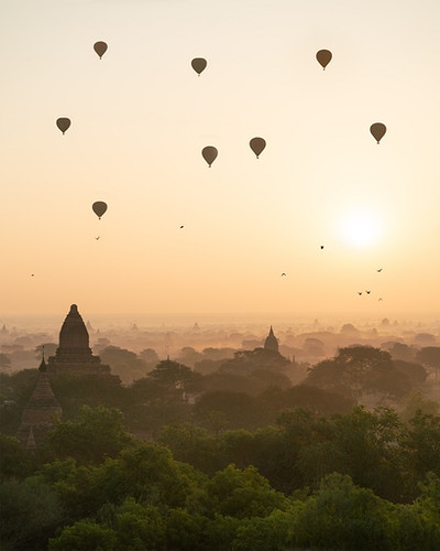 Hot-air balloons at sunrise floating over Bagan, Myanmar - Daniel John Photography