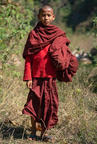 A young monk covered in spurs in Loikaw Myanmar - Daniel John Photography