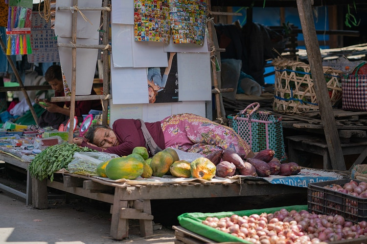 A woman taking a midday nap in a market in Inle Lake Myanmar - Daniel John Photography