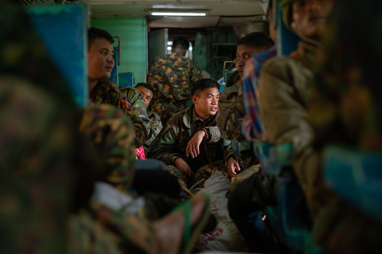 Soldiers on a train in Myanmar - Daniel John Photography