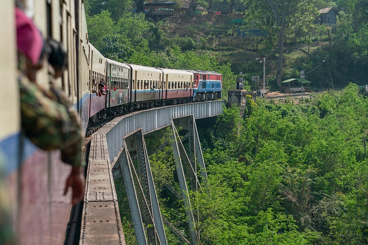 A train slowly moving across the Goteik viaduct - the tallest bridge in Myanmar - Daniel John Photography