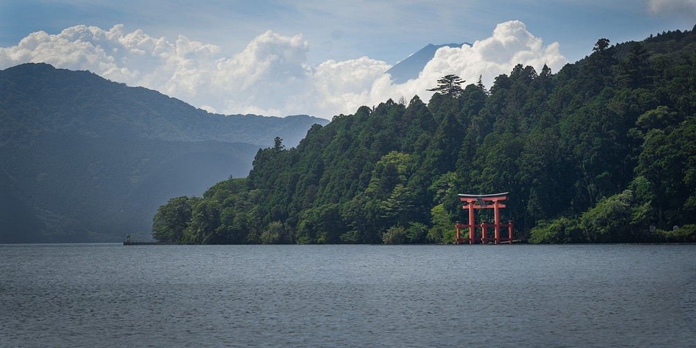 The Hakone Shrine torii gate in front of Mt. Fuji on Lake Ashi in Japan - Daniel John Photography