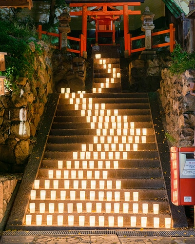 A staircase of candles leading to a Torii gate in Nara, Japan - Daniel John Photography