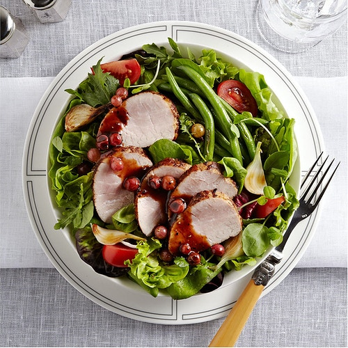 Roasted Pork on greens with beans and red currant sauce - Deborah Fletcher | Chicago Food • Product • Still-Life Photographer