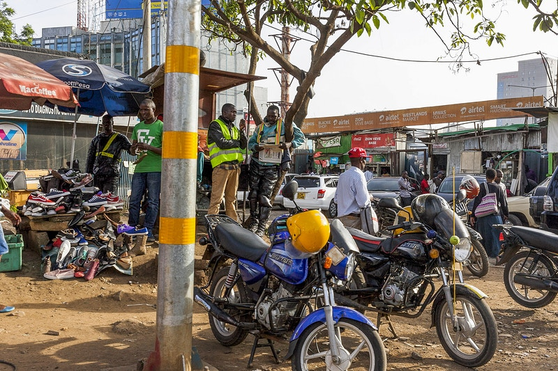 BIKE TAXI RANK NEAR WAIYAKI WAY PARKLANDS BEFORE DEMOLITION AND THE CONSTRUCTION OF THE NEW RING ROAD NAIROBI NOVEMBER 2017 - GRAHAM GUY BARRATT