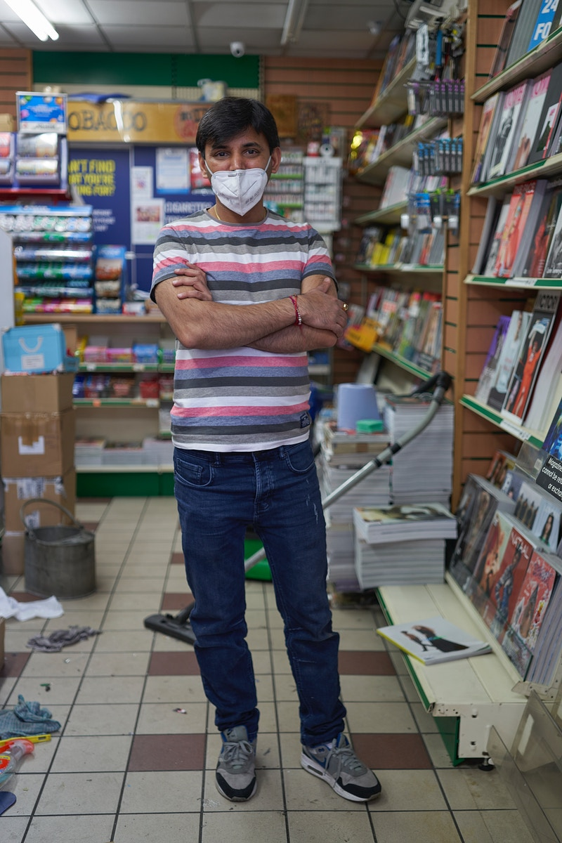 ASH. TIDYING AT HIS NOW CLOSED NEWSAGENTS CORNER OF BERWICK & BROADWICK STREETS SOHO LONDON WEDNESDAY 08TH MAY 17.16 DURING THE GREAT GLOBAL PANDEMIC OF 2020 - GRAHAM GUY BARRATT