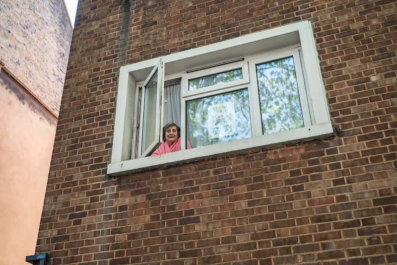 JUNE. AT HER WINDOW IN ROSEBERRY AVENUE WHERE SHE'S BEEN ISOATED ALREADY FOR 11 WEEKS APART FROM. LONDON 06TH MAY 16.25 DURING THE GREAT GLOBAL PANDEMIC OF 2020 - GRAHAM GUY BARRATT