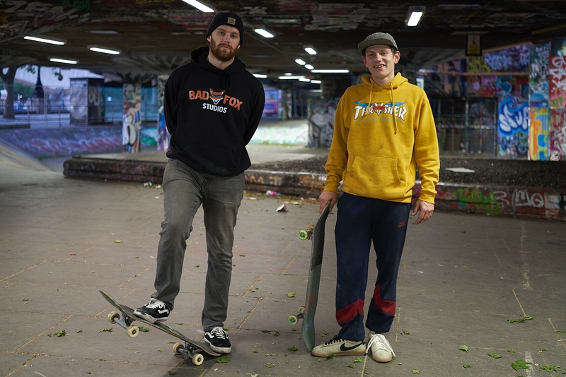 JONNY & ERNEST. REBEL SKATERS RIDING BEHIND THE FENCES THAT NOW SURROUND THE SOUTH BANK SKATE SPACE IN THE UNDERCROFT BENEATH THE QUEEN ELIZABETH HALL. LONDON TUESDAY 12TH MAY 20.48 DURING THE GREAT GLOBAL PANDEMIC OF 2020 - GRAHAM GUY BARRATT