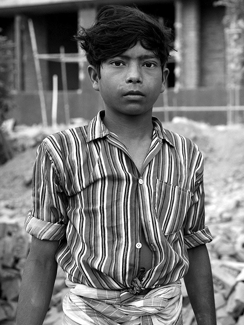 CHILD LABOURER ON BUILDING SITE - GRAHAM GUY BARRATT