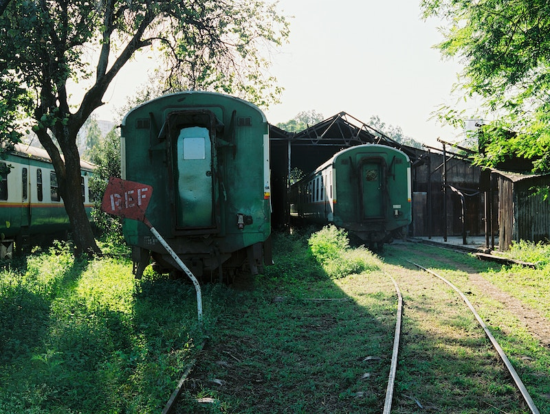 DERELICT RAILWAY CARRIAGES. NAIROBI. - GRAHAM GUY BARRATT