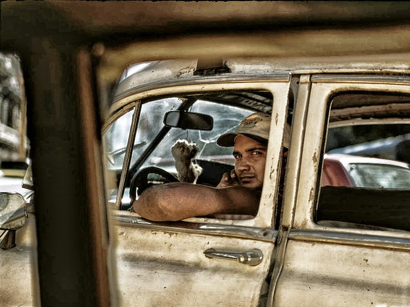 COOL RIDER AT THE LIGHTS OUTSIDE THE CUBA NATIONAL THEATRE IN PARQUE CENTRAL, HABANA VIEJA - GRAHAM GUY BARRATT