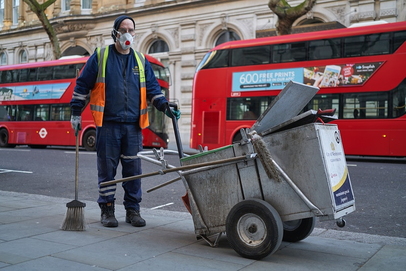 MARK. ONE OF THE FORGOTTEN FIRST LINE WORKERS. NORTHUMBERLAND AVENUE LONDON DURING THE GREAT GLOBAL PANDEMIC IN THE UK. 25TH MARCH 2020 - GRAHAM GUY BARRATT