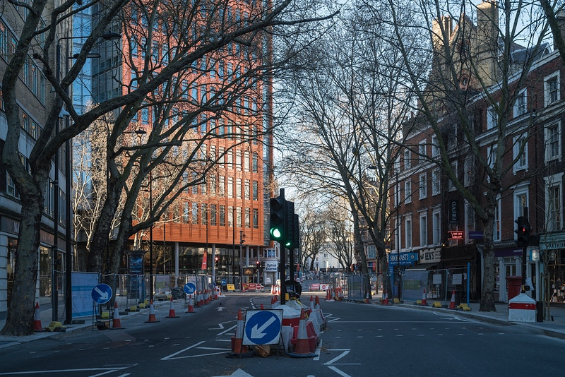 SHAFTSBURY AVENUE LOOKING NORTH AT THE END OF NEAL STREET COVENT GARDEN SATURDAY EVENING 04TH APRIL @ 18.15 DURING THE GREAT GLOBAL PANDEMIC OF 2020 - GRAHAM GUY BARRATT