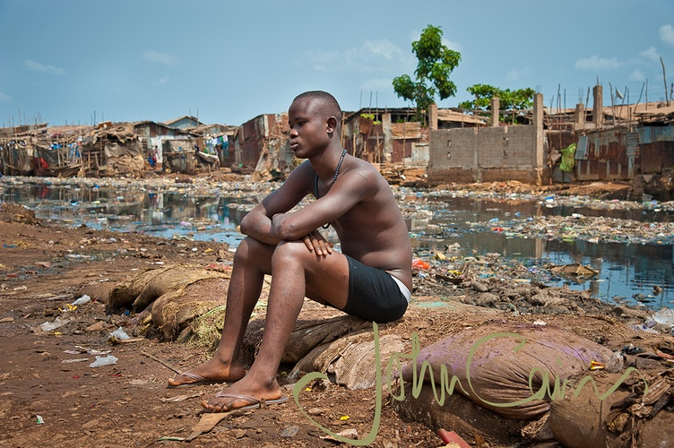 Philip from the Kroo Bay slums in Freetown, SIerra Leone - John Cairns Photography