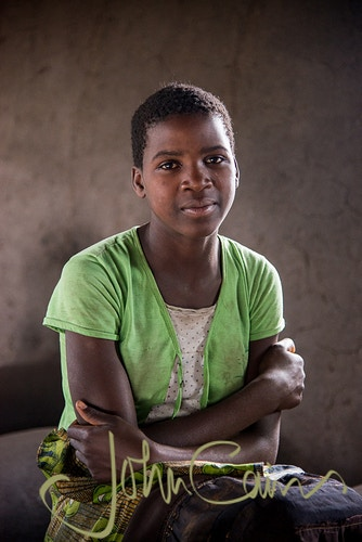 Elube - A sponsor child of World Vision in Southern Africa - John Cairns Photography