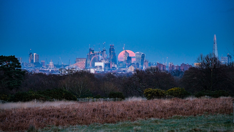 Blood supermoon rising over City of London - London Viewpoints