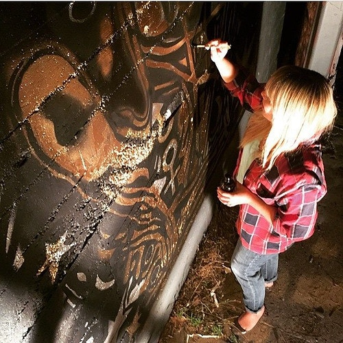 Painting the Palm Reader Mural. 2015. - Melissa Uroff