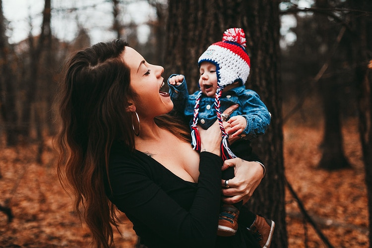 Mother and new baby laughing - Creative Portrait Photographer :: Portland, Maine - Savannah Daras