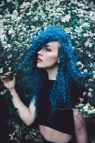 Vibrant blue curly hair self portrait amongst the spring flower blossoms, Portland Maine - Creative Portrait Photographer :: Portland, Maine - Savannah Daras