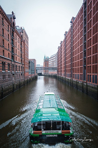 Speicherstadt cannal boat — in Hamburg, Germany. - Sebastian Lopez Photography