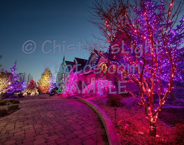 Colored Christmas lights along home entrance - Vance Brand Photography