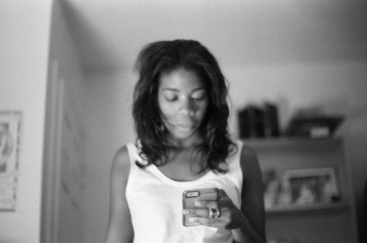 Whitney on her phone - Victor Cohen